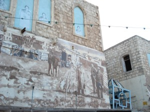 Zionist painting over a Palestinian home in Haifa