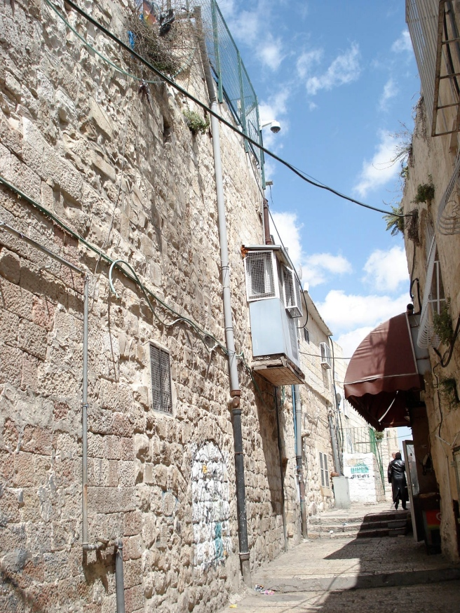 malwiyeh street with israeli terrorist colonists occupying a palestinian home