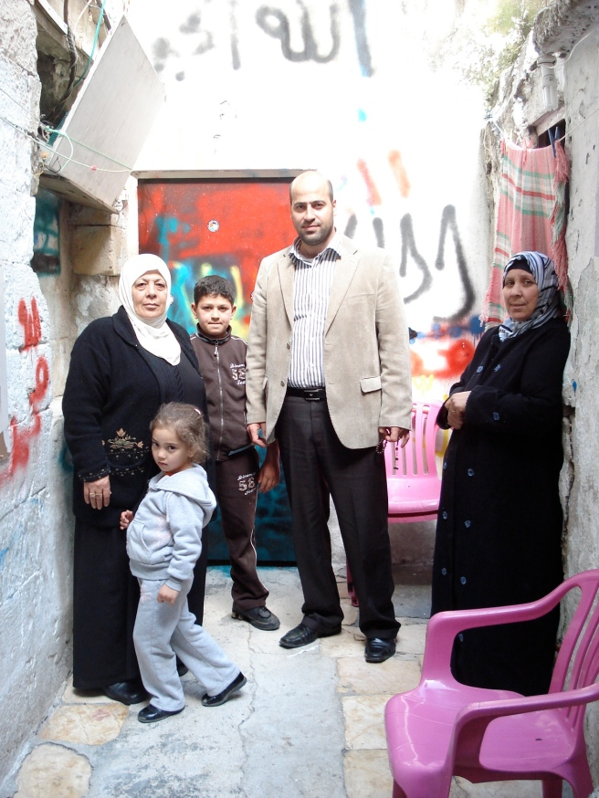 jaber family in front of room in their house occupied by israeli terrorists