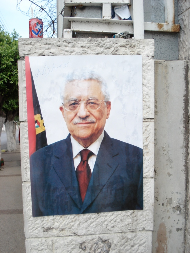 close up of posters around nablus of the leader of palestinian collaborationist authority