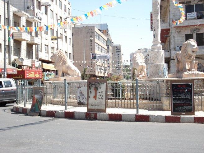 nakba posters in manara square, ramallah
