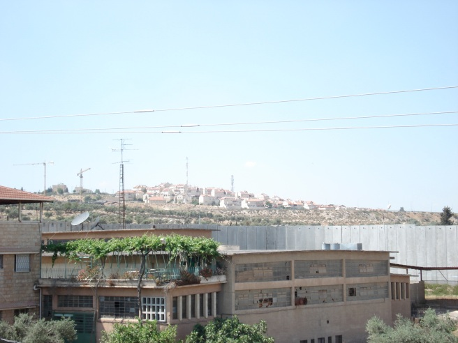 view of apartheid wall and gilo colony from aida refugee camp