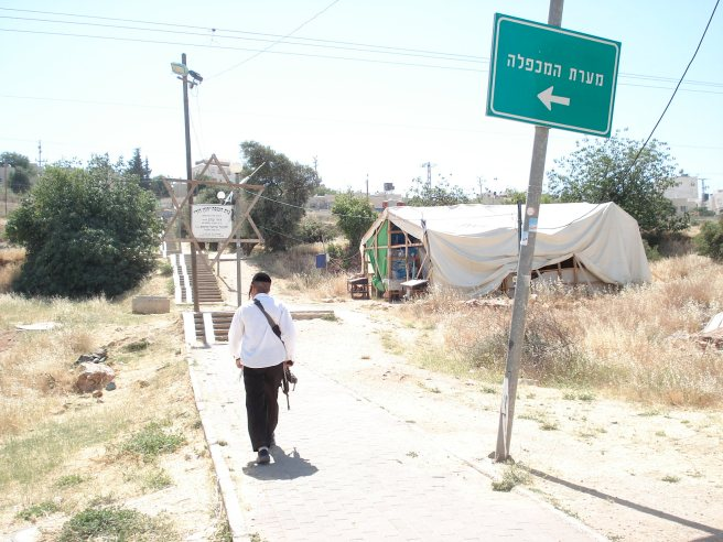 "israeli terrorist colonist walks to his new ""outpost"" colony (aka the tent)"