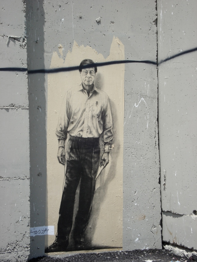 close up of mahmoud darwish painting on the apartheid wall