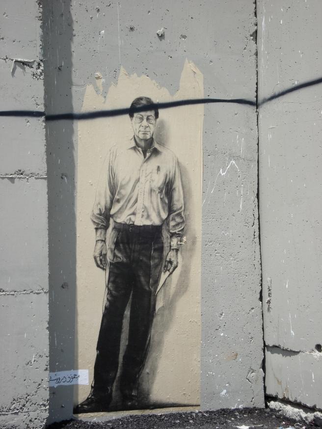 close up of mahmoud darwish painting on the apartheid wall