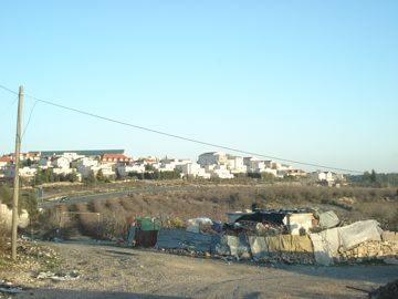 palestinian home in beit el sukariya, surrounded by zionist colony of gush etzion
