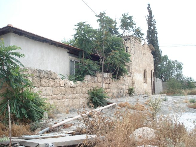 zionist terrorist colonist's house built onto a palestinian house in artuf