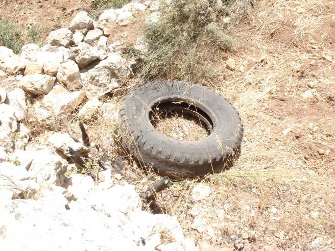 tire thrown into husan by zionist terrorist colonists (it was burning when thrown)