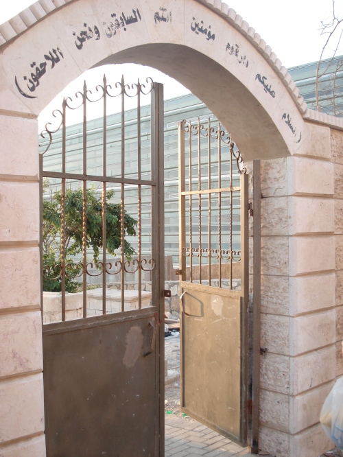 palestinian cemetery in yaffa with the so-called peres peace center behind